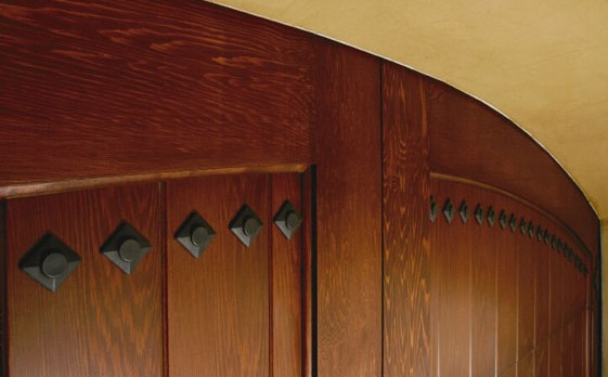 Clavos on a Natural Wood Garage Door